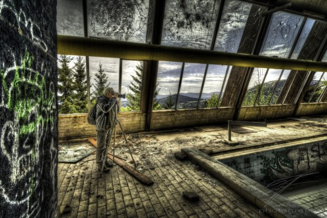 Under broken Windows - Frank taking a picture of the pool in the Clinique du Diable, an abandoned Clinic, Sanatorium, Hotel in Alsace, France