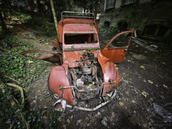 Broken Wings - Old, red car in the back of an abandoned mansion in France