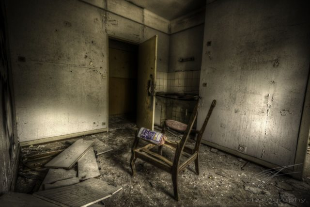Lonely Chair in the CLinique du Diable, an abandoned sanatorium / hospital / hotel in Alsace, France