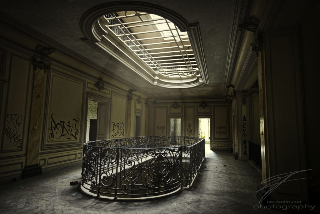 Light in the Hallway - Light trhough the atrium in the Château Lumière, an abandoned mansion / villa in Alsace, France